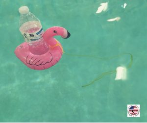 a flamingo floatie floating in the pool