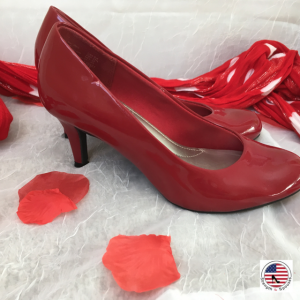 red heels surrounded by rose petals