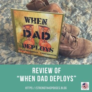 """The book """"When Dad Deploys"""" leaning against boots"""