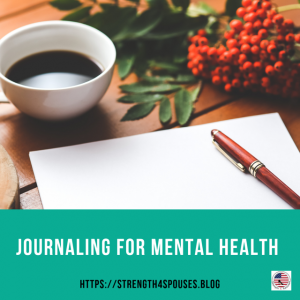 A journal open with a cup of coffee next to it