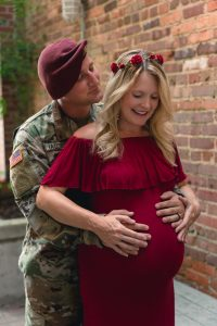 Wendi and her husband holding her baby bump