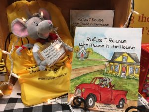 """the cover of the book """"Rufus T. Rouse, Wee Mouse in the House"""" with a stuffed mouse sitting next to it"""