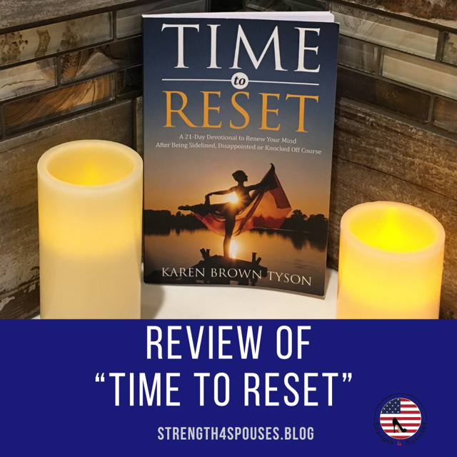 """""""Time to Reset"""" book sitting between two candles"""